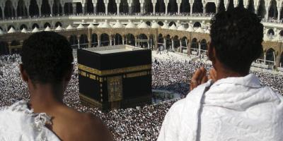 Muslim pilgrims praying infront of the Kabah at the Sacred Mosque in Makkah, towards which all Muslims face when they pray.