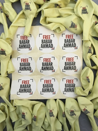 Stickers and balloons from the Free Babar Ahmad campaign