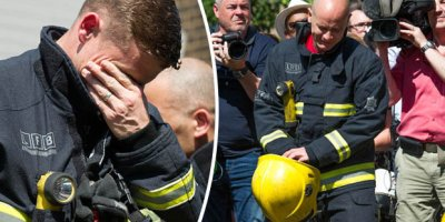 London firefighters weep during minute's silence held for victims of Grenfell Tower fire tragedy. Image courtesy of Daily Star.